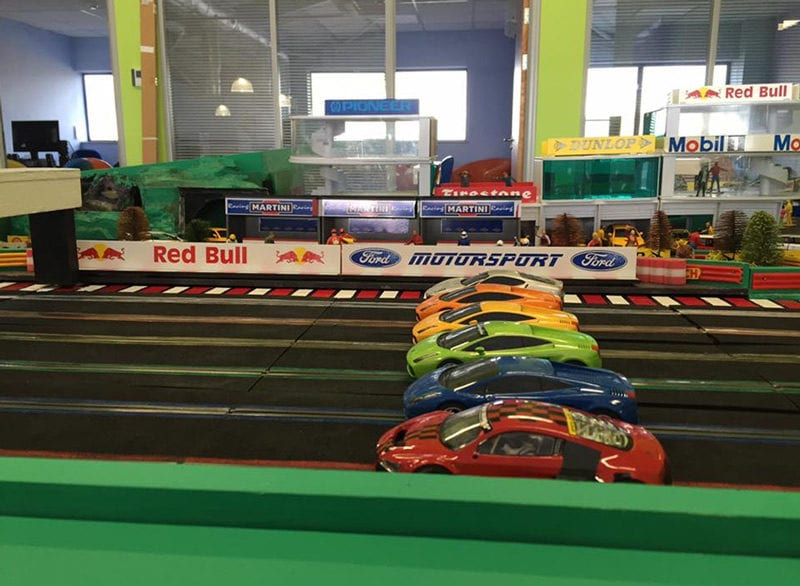 Cars ready to go on 6 lane scalextric
